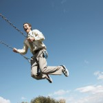 young-businessman-on-swinging-smiling_pop_14333