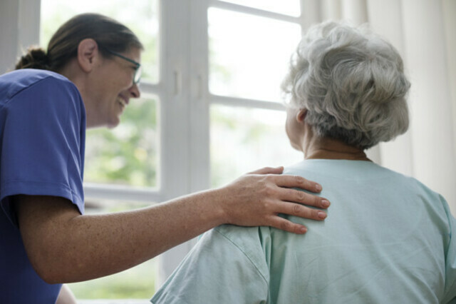 Nurse taking care of an old woman